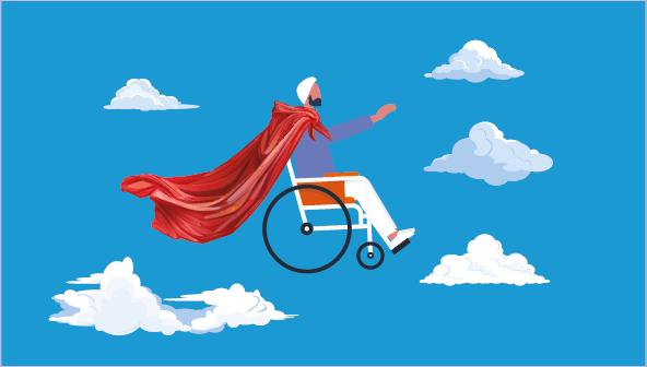 Bulutlar üstünde kırmızı peleriniyle süzülen tekerlekli sandalyeli erkek birey.