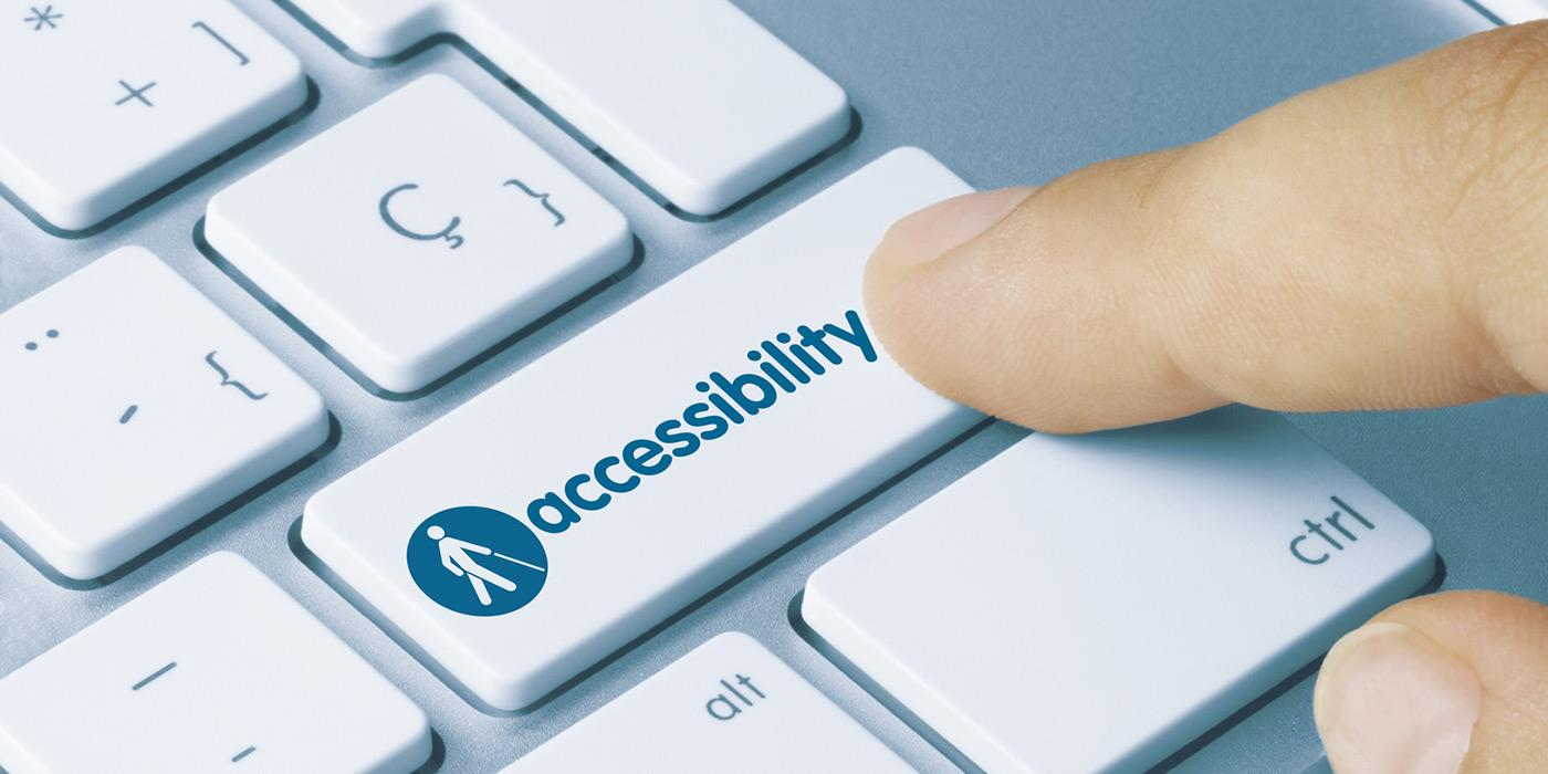 Bilgisayar klavyesinin Enter tuşu üzerinde bir tekerlekli sandalye çizimi. Sağında ingilizce olarak, erişilebilirlik yazıyor.
